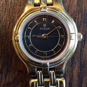 Vintage Titan stainless steel gold tone watch.